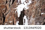 freezing waterfall. big icicles ... | Shutterstock . vector #1313469020