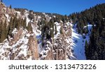 large rock covered with snow.... | Shutterstock . vector #1313473226