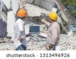 Small photo of Engineer architect and worker operation control demolish old building.
