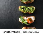 fresh tasty bruschettas on dark ... | Shutterstock . vector #1313522369