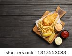 british traditional fish and... | Shutterstock . vector #1313553083