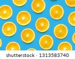 orange slices on a colored... | Shutterstock . vector #1313583740