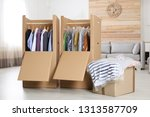 cardboard wardrobe boxes with... | Shutterstock . vector #1313587709
