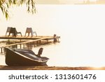 sunrise over the lake with boat ... | Shutterstock . vector #1313601476