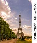 the eiffel tower in daylight... | Shutterstock . vector #1313625029