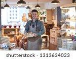 portrait of smiling male owner...   Shutterstock . vector #1313634023