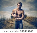 Small photo of strong handsome man with rope
