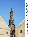 view of the tower and spire... | Shutterstock . vector #1313665580