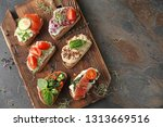 fresh tasty bruschettas on... | Shutterstock . vector #1313669516