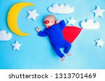 little baby superhero with red... | Shutterstock . vector #1313701469