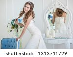young beautiful bride with... | Shutterstock . vector #1313711729