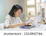 young asian businesswoman... | Shutterstock . vector #1313842766