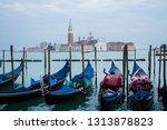 gondolas docked on the grand... | Shutterstock . vector #1313878823