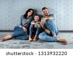 happy family sitting on the... | Shutterstock . vector #1313932220