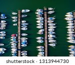 moored yachts   aerial view | Shutterstock . vector #1313944730