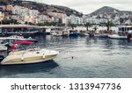 seafront and boats on the dock... | Shutterstock . vector #1313947736
