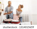 happy couple packing clothes... | Shutterstock . vector #1314015659