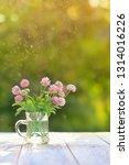 bouquet of pink clover on... | Shutterstock . vector #1314016226