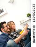 young couple using tablet on... | Shutterstock . vector #1314028253