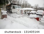 Snow Plow Removing Snow From...