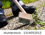 man working with weed brush | Shutterstock . vector #1314052013