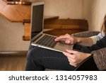 the girl with the laptop sits... | Shutterstock . vector #1314057983