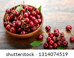 sweet red cherries in a plate... | Shutterstock . vector #1314074519