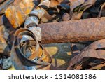 rusty metal waste lying... | Shutterstock . vector #1314081386