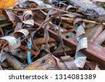rusty metal waste lying... | Shutterstock . vector #1314081389