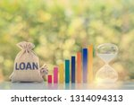 Small photo of Continuous loan repayment / ordinary annuity concept : Loan bag, rising bar graph, hourglass on a table, depict borrower borrow money from lender and repay or payback regularly in same or equal amount