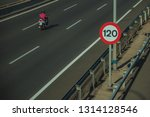 lonely motorcycle passing... | Shutterstock . vector #1314128546