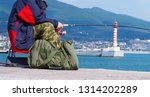 a man sitting on the dock in... | Shutterstock . vector #1314202289