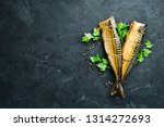 Stock photo smoked fish mackerel on a black stone background top view free copy space 1314272693
