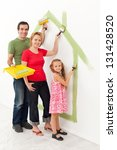 Family in their new house - making it a cozy home together concept - stock photo