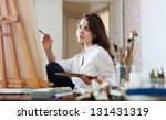Woman Paints Picture On Canva...