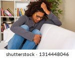 black woman crying alone at... | Shutterstock . vector #1314448046