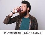 handsome brunette bearded man ... | Shutterstock . vector #1314451826