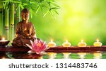 Buddha Statue With Candles In...