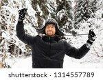 man in fur winter hat with ear...   Shutterstock . vector #1314557789