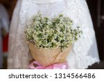lovely bride holding a bouquet... | Shutterstock . vector #1314566486