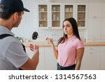 young woman look at plumber.... | Shutterstock . vector #1314567563