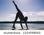 silhouette of a little acrobat... | Shutterstock . vector #1314598043