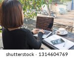 cute freelance woman using... | Shutterstock . vector #1314604769