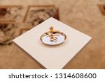 gold wedding rings on stand for ...   Shutterstock . vector #1314608600
