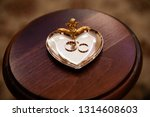gold wedding rings on stand for ...   Shutterstock . vector #1314608603