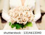 bride holding her bouquet ...   Shutterstock . vector #1314613340