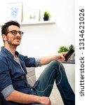 handsome young man using... | Shutterstock . vector #1314621026