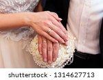 wedding couple hands with...   Shutterstock . vector #1314627713