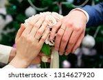 wedding couple hands with...   Shutterstock . vector #1314627920
