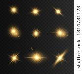 glowing golden lights and stars.... | Shutterstock .eps vector #1314731123